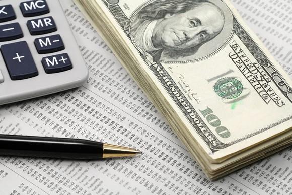 Dividend Cash On Financial Newspaper Getty
