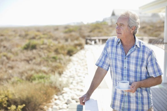 Older Man Looking Out At Scenery
