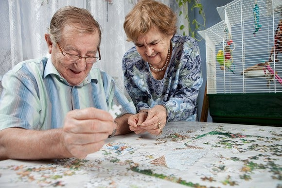 Retired Couple Doing A Puzzle