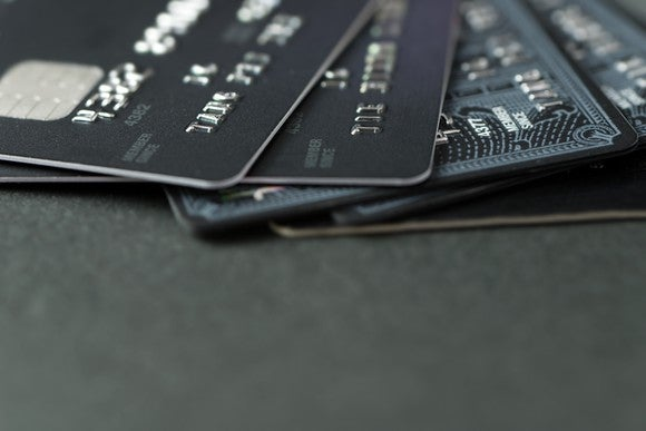 Five credit cards fanned out on table