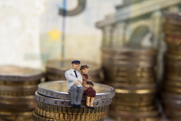Couple sitting on coin stack