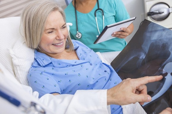 Senior In Hospital Smiling Following Hip Surgery Doctor Getty