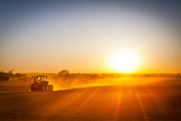 Picture of tractor on farm at sunset