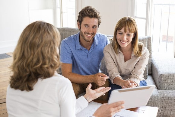 A couple talking to a financial planner