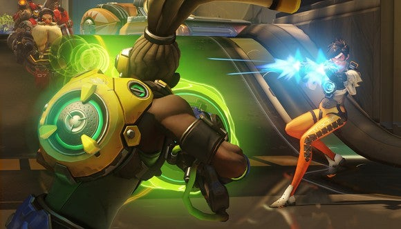 "Screen shot from Activision Blizzard's video game ""Overwatch"" featuring three characters facing off with guns."