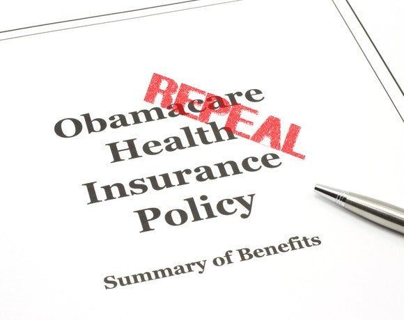 "Obamacare insurance policy stamped with the word ""repeal."""