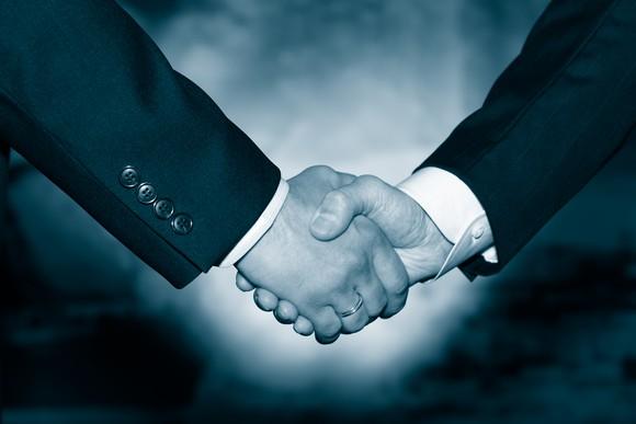Businessmen shaking hands in agreement.