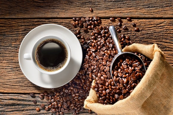 Coffee cup and coffee beans on a table