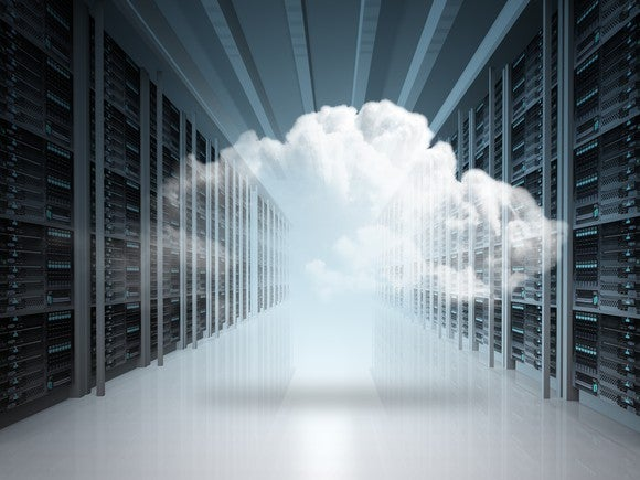 A long aisle of servers with a cloud floating in the middle of it.