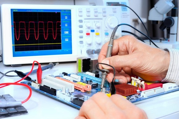 Using an oscillator to test electronic equipment.