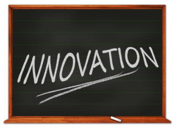 """The word """"innovation"""" written on a chalkboard."""