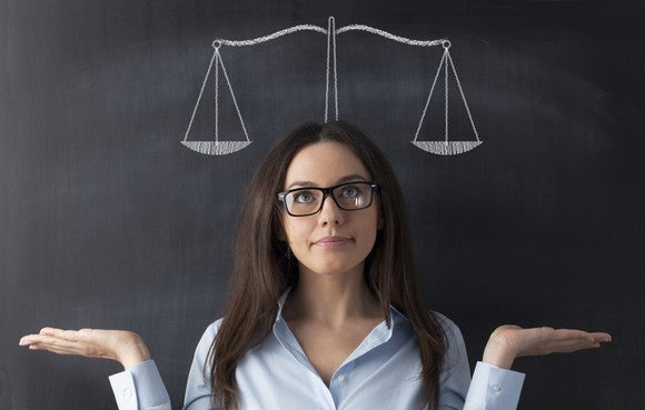 Woman wearing eyeglasses weighing a decision