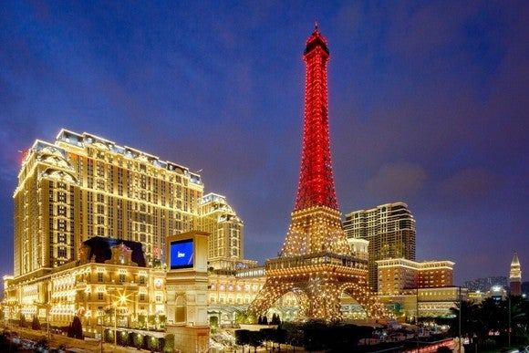 Parisian resort and casino with scale version of Eiffel Tower at night