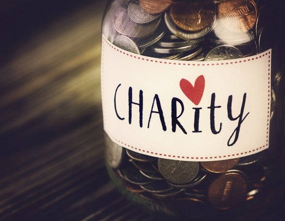 """Jar of coins labeled """"charity""""."""