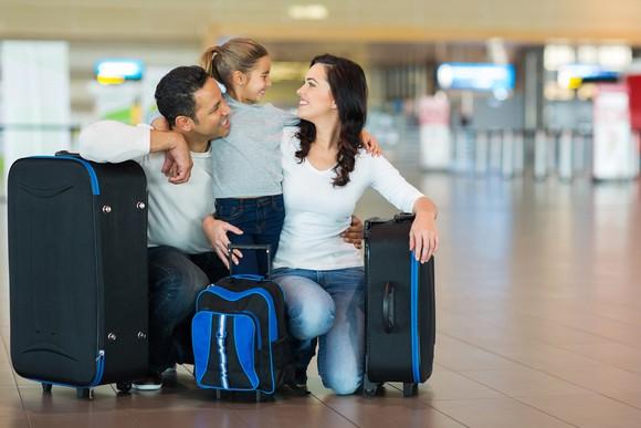 Family at airport preparing for flight.