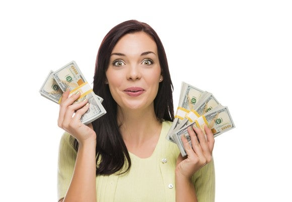 Excited woman with hands full of money