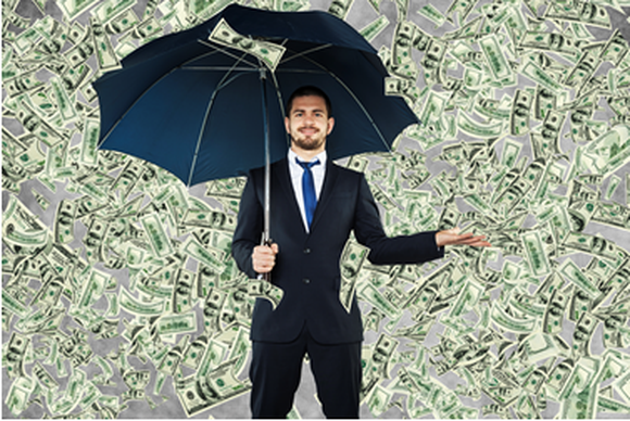 Money raining down on a man holding an umbrella.