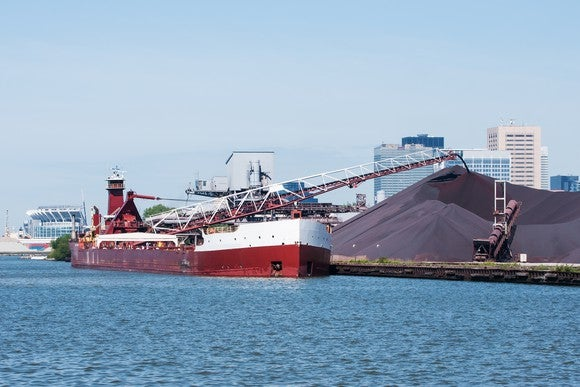 Ship unloading iron ore cargo.