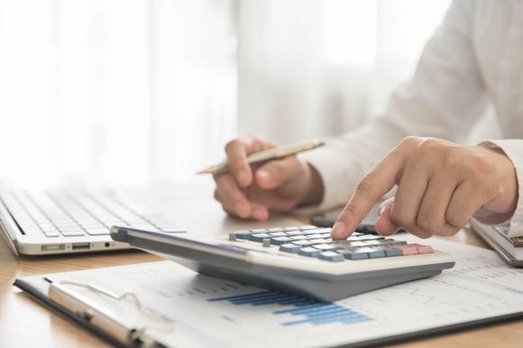 Man using a finance calculator.