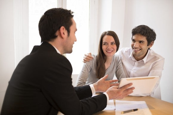 Couple meeting with mortgage broker