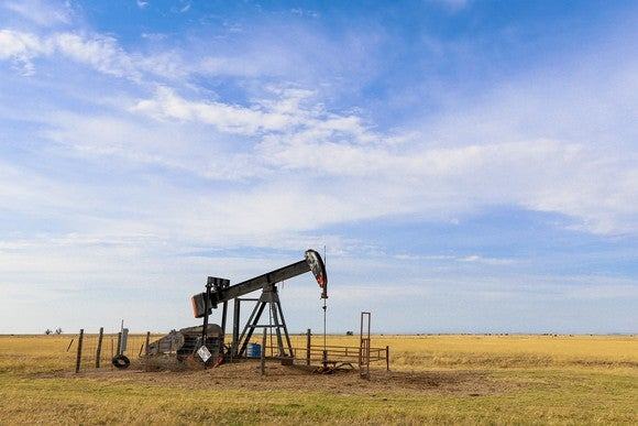 An oil derrick operating on the plains of the Oklahoma panhandle