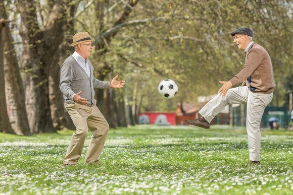 Older men playing soccer