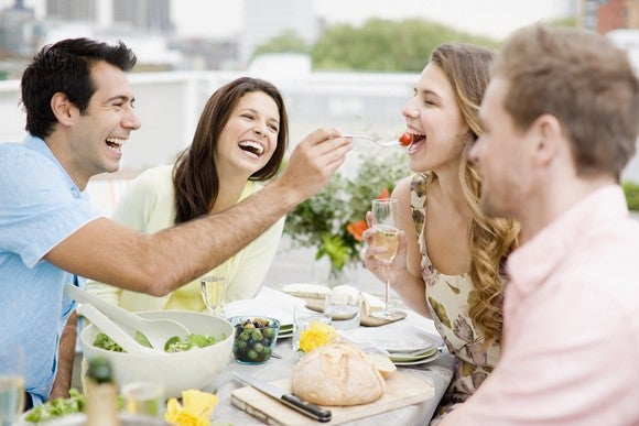 Group of 30-somethings dining and laughing