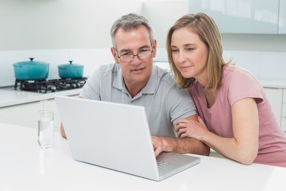 Couple looking at laptop computer.