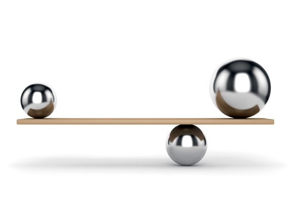 Metal balls balancing on plank