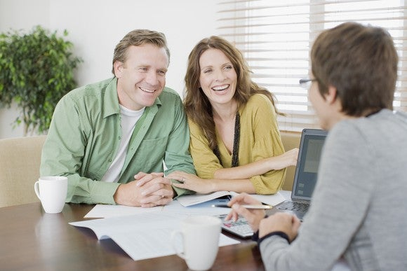 Couple meeting with their financial adviser.