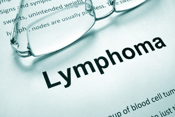 "Paper with word ""lymphoma"" and glasses"