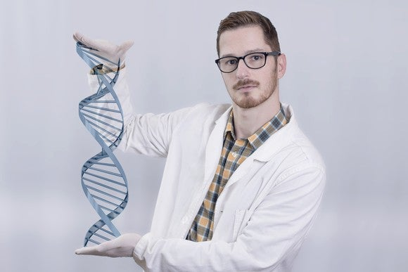 Lab researcher with a DNA double helix