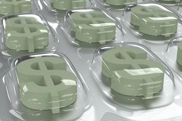 Dollar signs inside pill packaging, representing overpriced medicine