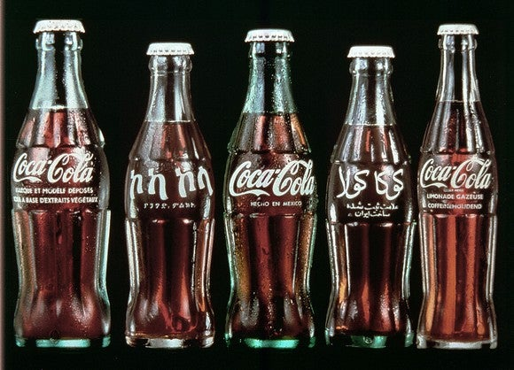 Coca-Cola bottles from around the world with labels in different languages.