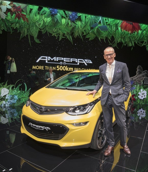 Opel CEO Karl-Thomas Neumann with an Opel Ampera-e electric car at the Paris Motor Show in October 2016.