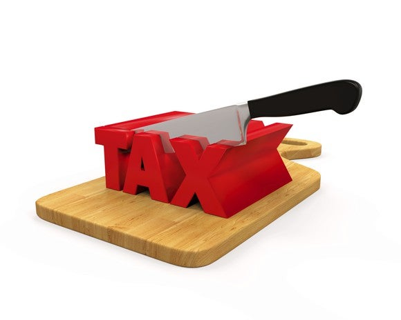 "The word ""tax"" 3-dimensional in red, being cut by a knife on a cutting board"