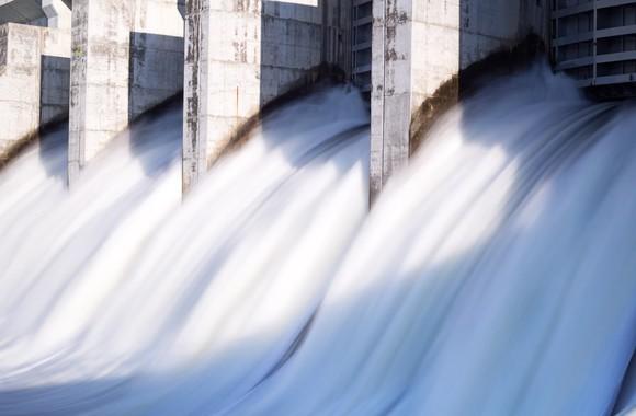 Water rushing through a hydro dam's gates.