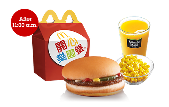 A McDonald's Happy Meal from one of its Hong Kong locations. The meal is tailored to local tastes and includes a burger, side of corn, and orange juice.