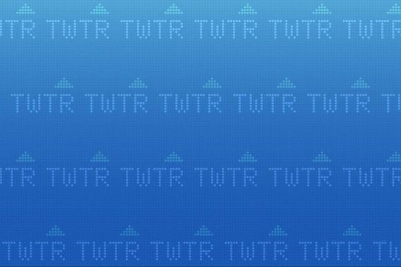 Twitter's TWTR ticker symbol against a blue background.