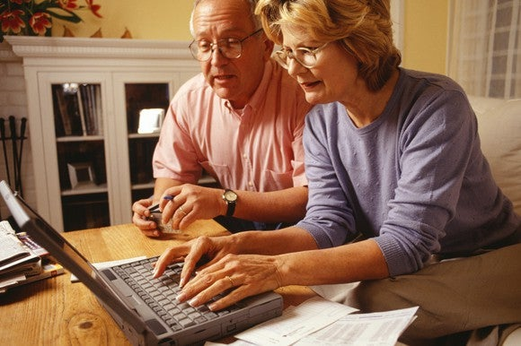 Senior couple using a laptop.