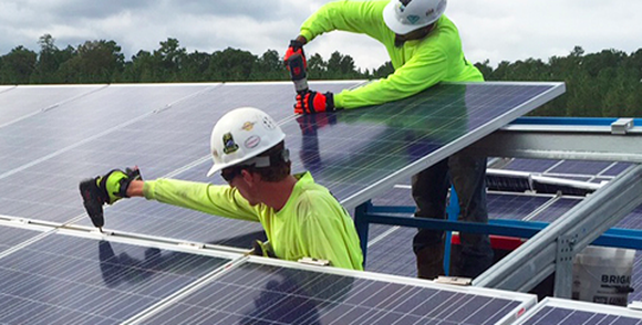 Southern Co employees working on a solar installation.