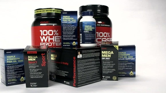 An assortment of GNC-branded products.