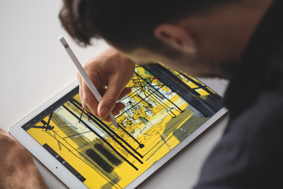 Man using an iPad Pro and Apple Pencil