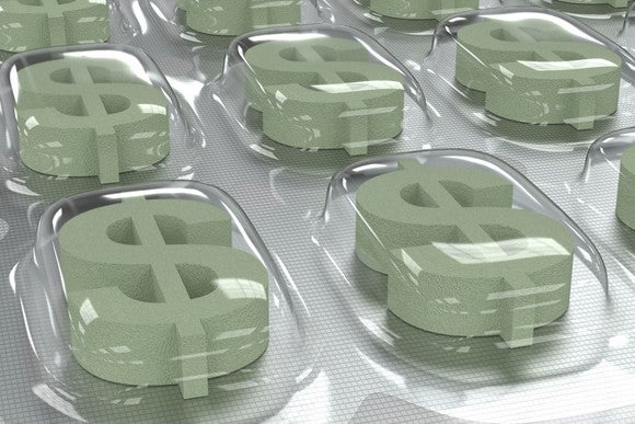 Dollar signs contained within pill packaging, signifying high drug prices.