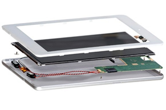 Three component layers of a tablet shown hovering above one another.