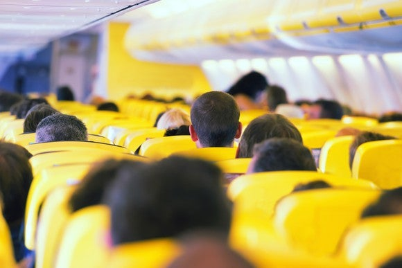 Interior of a crowded airplane.
