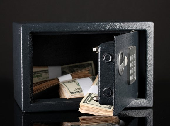 A small safe, with its door open and money inside