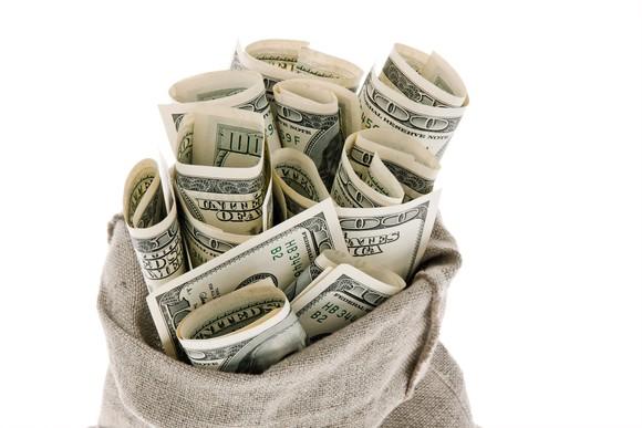 Bag of 100 dollar bills.