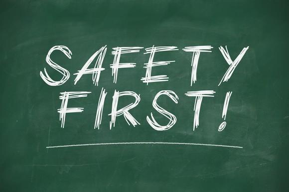 """safety first"" written on chalk board"
