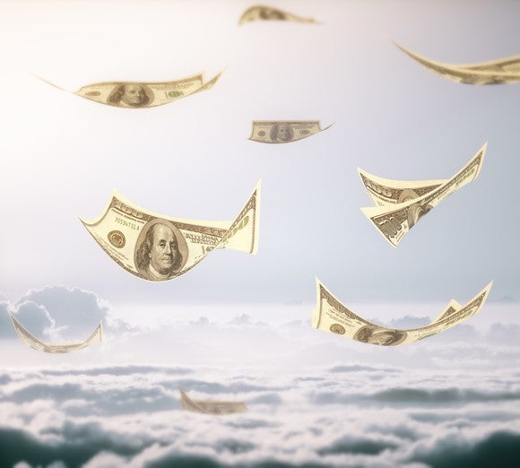 $100 bills flying above clouds